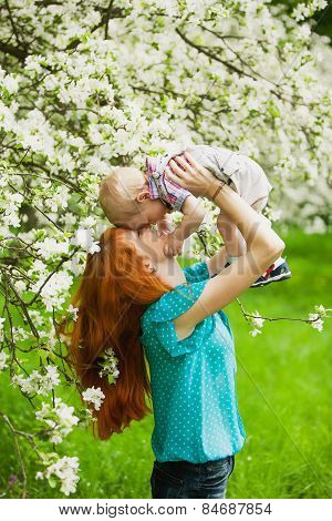 Portrait Of Happy Happy Mother And Son In Spring Garden