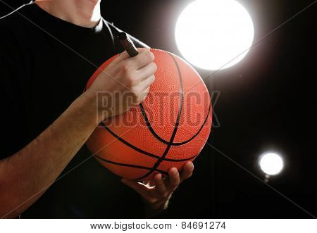 Autographs by basketball star on black and lights background