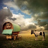 An Old Gypsy Caravan Trailer Wagon with a Horse poster