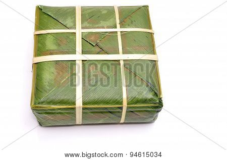 stuffed sticky rice cake or Banh Chung on a white background