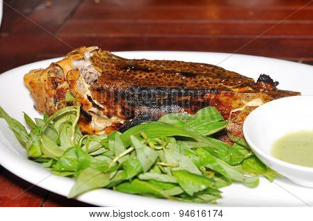 Grilled boxfish on the dish in the restaurant