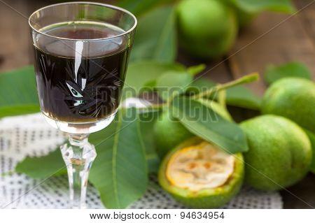 Glass of walnut liqueur