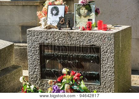 PARIS FRANCE - SEPT 12 2014:Jim Morrison grave in Pere-Lachaise cemetery Paris. Each year thousands fans and curious visitors come to pay homage to Jim Morrison's grave