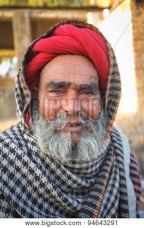 GODWAR REGION, INDIA - 14 FEBRUARY 2015: Elderly Rabari tribesman with red turban and blanket on head. Rabari or Rewari are an Indian community in the state of Gujarat.