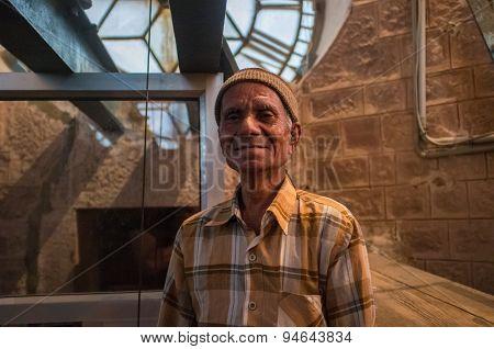 JODHPUR, INDIA - 11 FEBRUARY 2015: Ghanta Ghar clock man stands next to clock mechanism inside tower.
