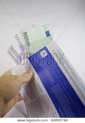 Hand Holding Tax Free Envelope With Thousands Of Euro