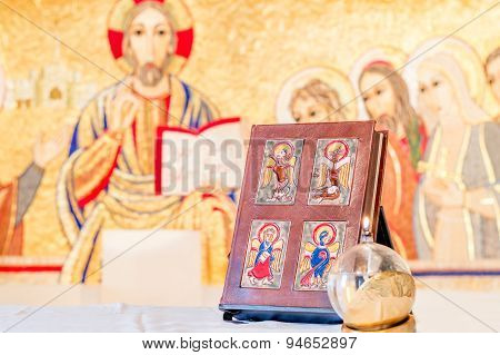 The book of Gospel on the altar with Jesus Christ