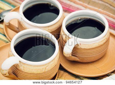 Three Ceramic Cups Of Coffee