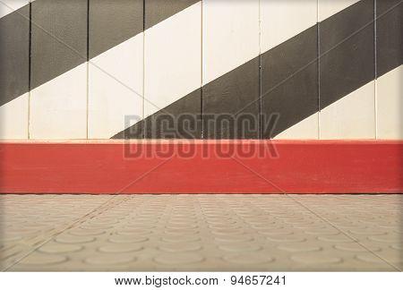 Empty panel wall and tile floor