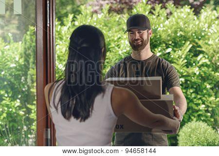 Deliveryman Making A Door To Door Delivery
