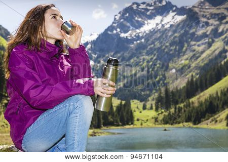 Woman Drinking Water During Hiking
