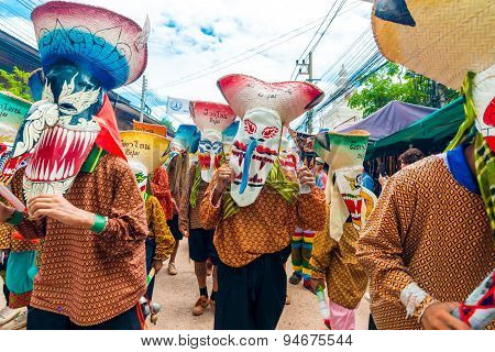 """LOEI PROVINCE THAILAND-JUNE 27: People at Ghost Festival (Phi Ta Khon) Ghost masked procession celebrated on religious tradition """"Boon Pra Wate"""" at Dan Sai district Loei June 272015."""