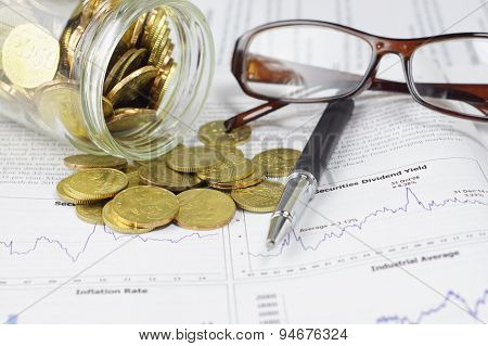 Gold Coins, Pen And Glasses - Business Concept