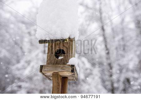 Snow Piled High On A Wooden Bird Box