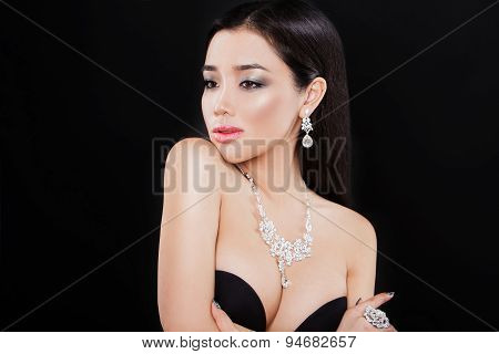 beautiful young asian woman posing with jewelry