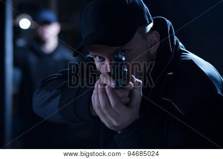 Policeman Aiming Gun During Intervention