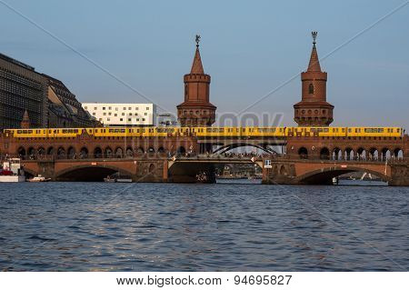 oberbaum bridge with train - berlin kreuzberg