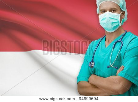 Surgeon with flag on background - Monaco poster