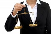 Business woman holding the justice scale against white poster