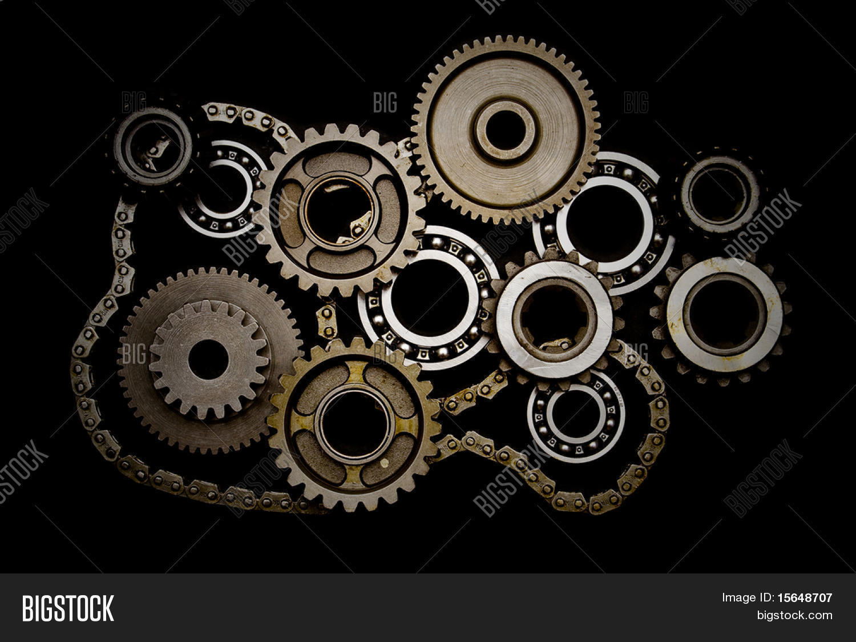 Set gears ball bearings chain image photo bigstock set of gears ball bearings and chain isolated on black background toneelgroepblik Images