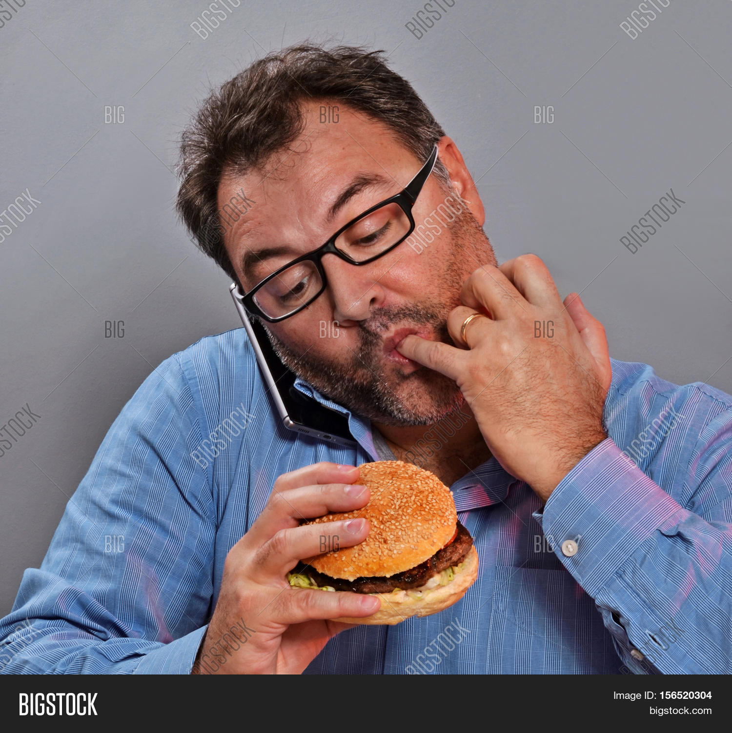 the man eating hamburger essay After all, it is the individuals choice where, and what to eat, but on another note, fast food restaurants have a very appealing way in getting buyers, and basically tricking society into eating processed junk food that is high in calories and fats.