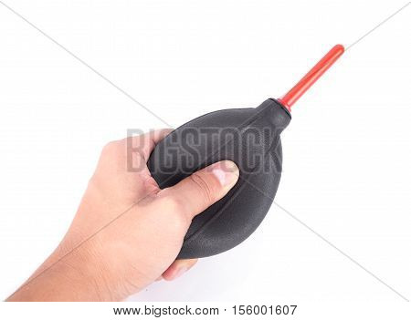 hand holding air dust blower for camera cleaning isolated on white background