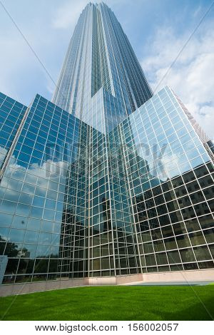 Houston, Texas, USA - August 14, 2016: Towering glass curtain wall with architectural reflections of skyscraper modern building know as Williams tower, Galleria district, Houston