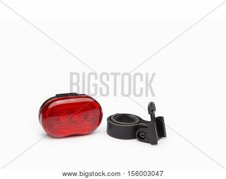Rear red reflector with holder for bicycle on a white background