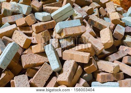 Heap of orange brick blocks, Brick blocks material for construction, Scatteredly of brick blocks heap, Non assembled brick blocks,