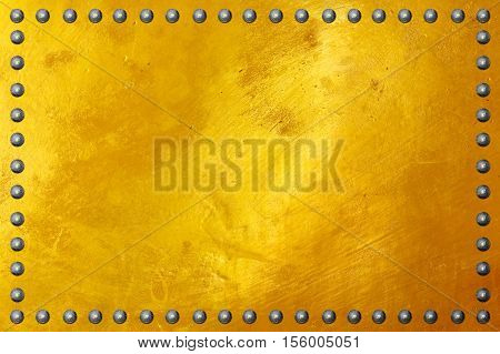Gold polished metal plate texture with rivet.