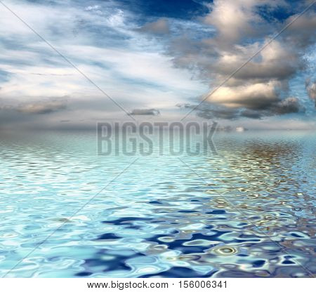 calm surface of the ocean and beautiful skyscape