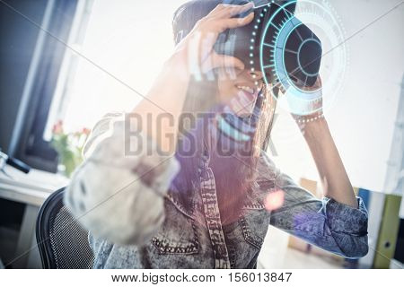 Digital image of volume knob against woman using virtual reality headset