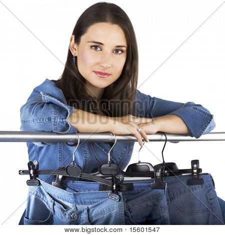 Woman presenting selection of jeans