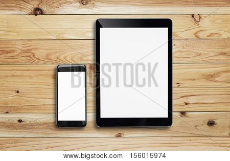 Tablet and smartphone on wood table. tablet white screen. tablet white display. tablet can connect to Wi-Fi. tablet to watch movies. tablet users play games. black color tablet
