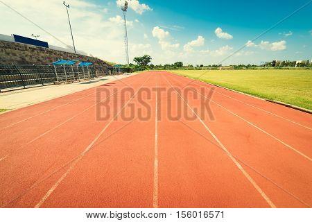 Red Running Track In Stadium. Running Track On Blue Sky.