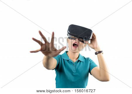 Young woman watching though the VR device isolated on white background.