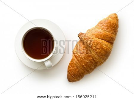 Tasty buttery croissant and cup of coffee isolated on white background.