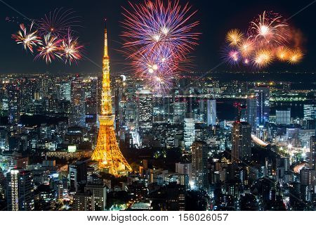 Beautiful fireworks over abstract modern building in city celebrates new year in night time