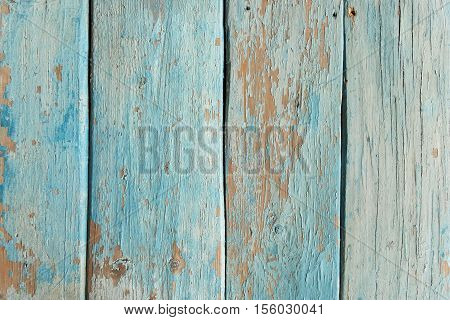 A fragment of the surface of an old wooden kitchen table. Texture background
