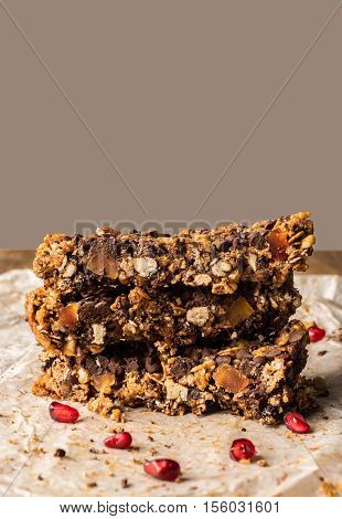 healthy homemade muesli bar with cereal chocolate and pomegranate and copyspace