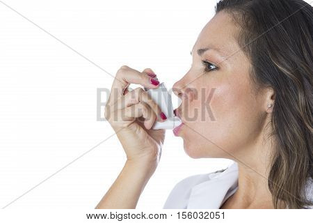 Female doctor is using a pressurized cartridge inhaler on a medical demonstration - Isolated on a white background