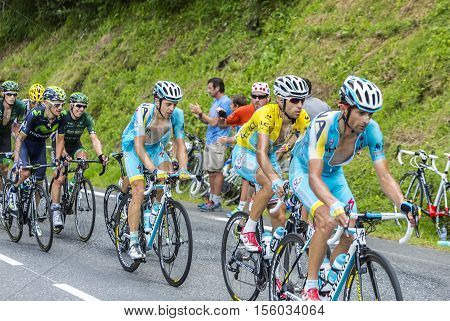 Col du Tourmalet France - July 242014: The cyclist Vincenzo Nibali in Yellow Jersey in front of a part of the peloton is climbing the road to Col de Tourmalet in the stage 18 of Le Tour de France 2014.