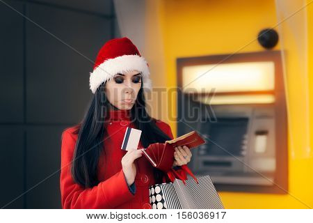 Christmas Woman Checking her Wallet in Front of a Bank ATM