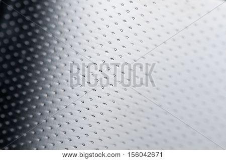 Glossy black metal texture background macro shot
