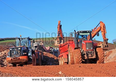 Tractor and Front Loader on a road construction site