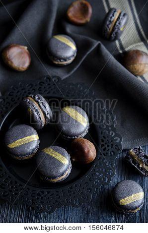 Black macaron with chesnut ganache and caramel