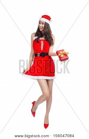 Full length portrait of a asian woman in santa claus cloth holding gift box isolated on a white background