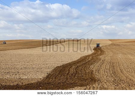 the agricultural field, which plowed into a tractor preparing the ground for planting. Spring