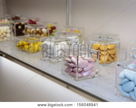 Colourful Sugared Almond In Glass Cubic Jars