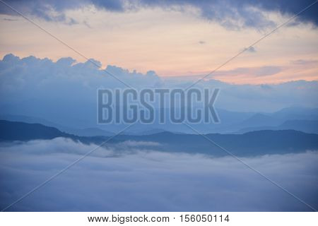 Landscape Mountain and mist in the morning at Doi Pha Chu in Si Nan National Park, Nan Province, Thailand
